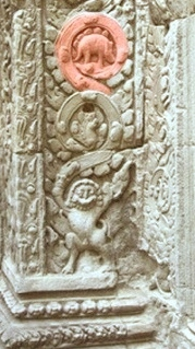 Temple pillar showing odd carving at base
